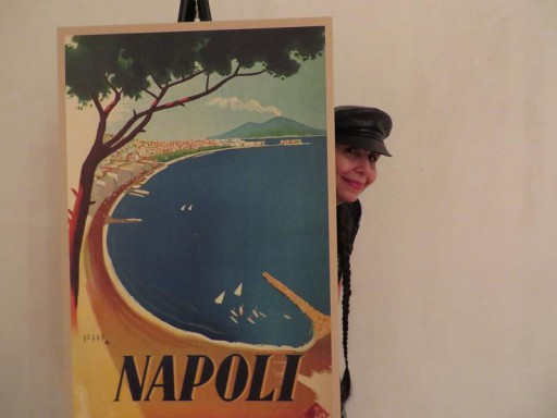 Our journalist LindaAnn LoSchiavo peeking from a Napoli poster at the Ospitalita` Italiana event.