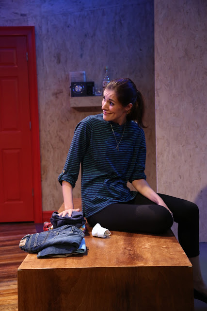 Donna (Mary Lauren) enjoys a short moment as a normal mom.  Photo by Gerry Goodstein.